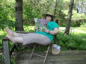 Me on the back deck reading a gardening book