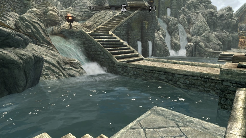 Location from Skyrim fantasy game with stone steps alongside a river and waterfalls.